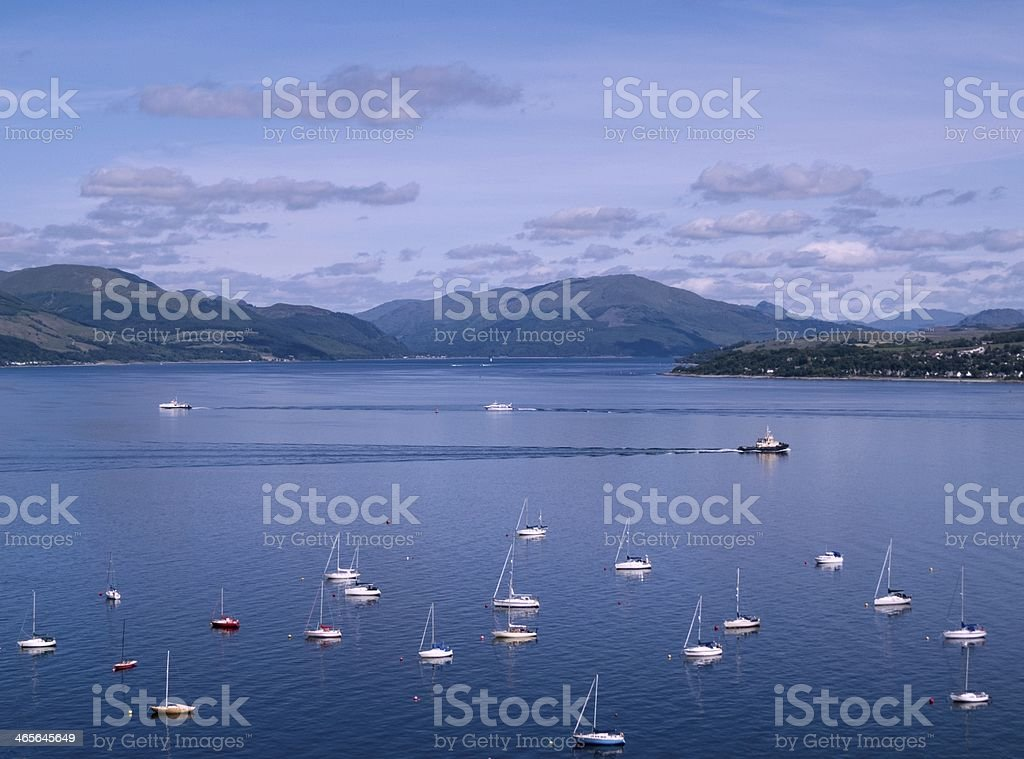 Blue Sea, Sky and Mountains stock photo