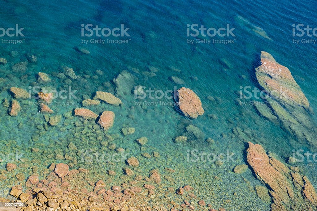 blue sea water at rocky beach in Zakynthos, Greece stock photo