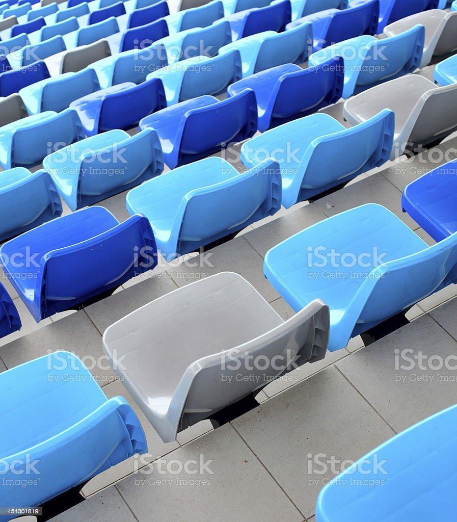 Blue seats at stadium royalty-free stock photo