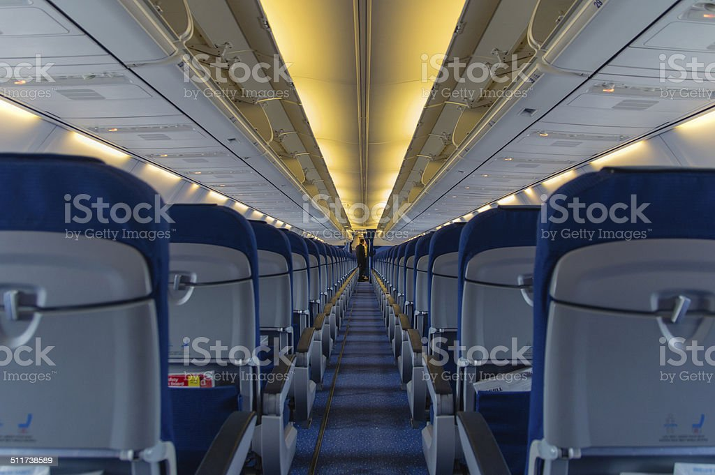 Blue seats in empty airplane stock photo