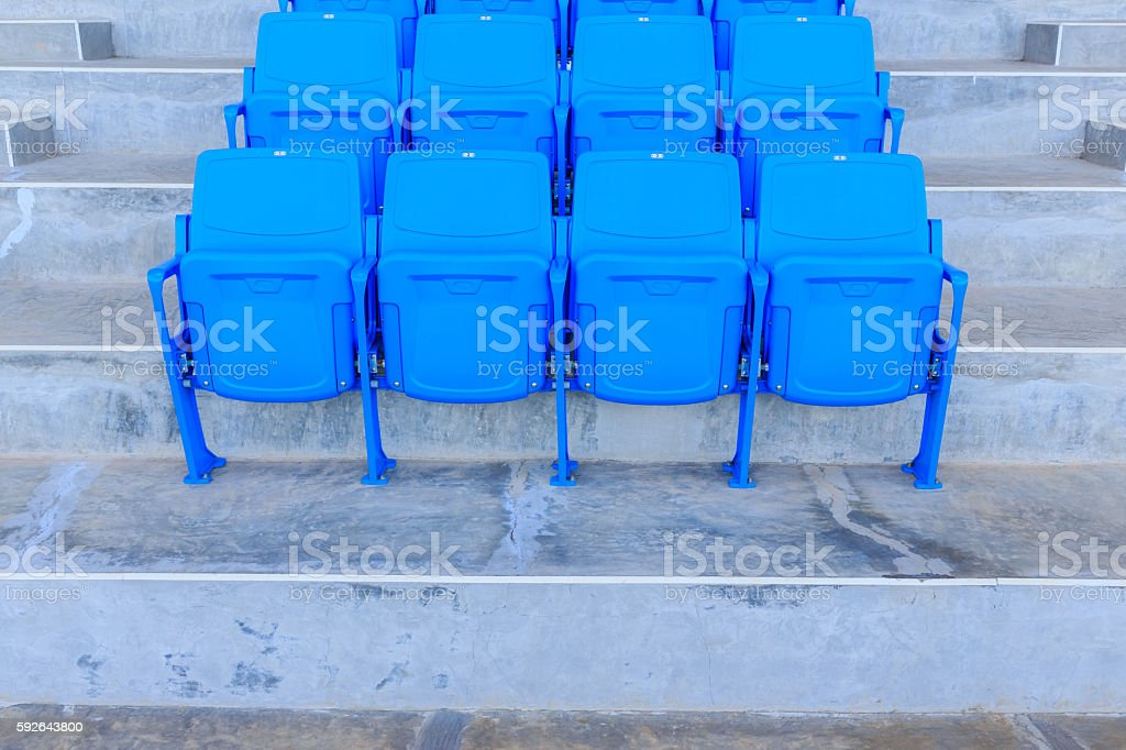 Blue seats in row on stadium stock photo