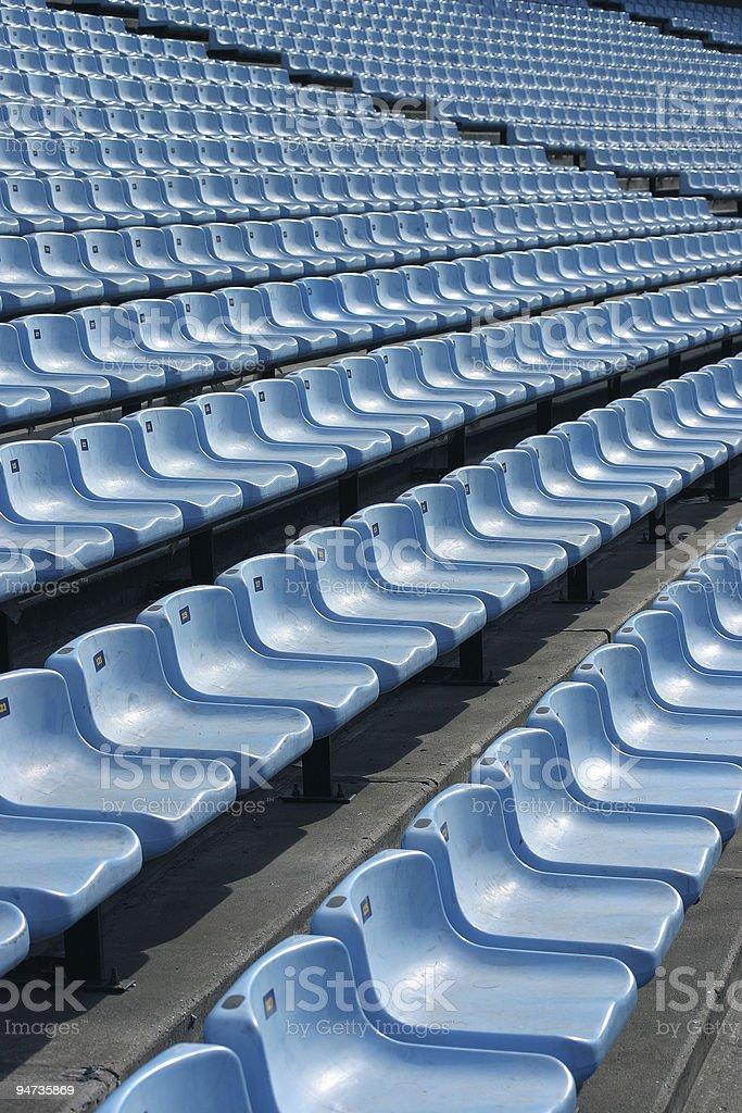 Blue seats in stadium stock photo