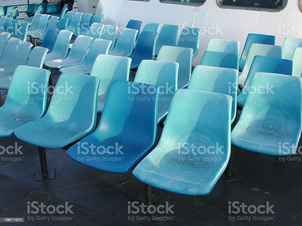Blue seats on ferry deck stock photo