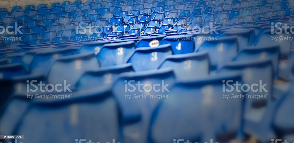 Blue seats on fokus in stadium stock photo