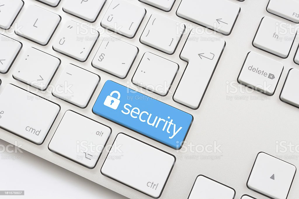 A blue security key on a keyboard stock photo