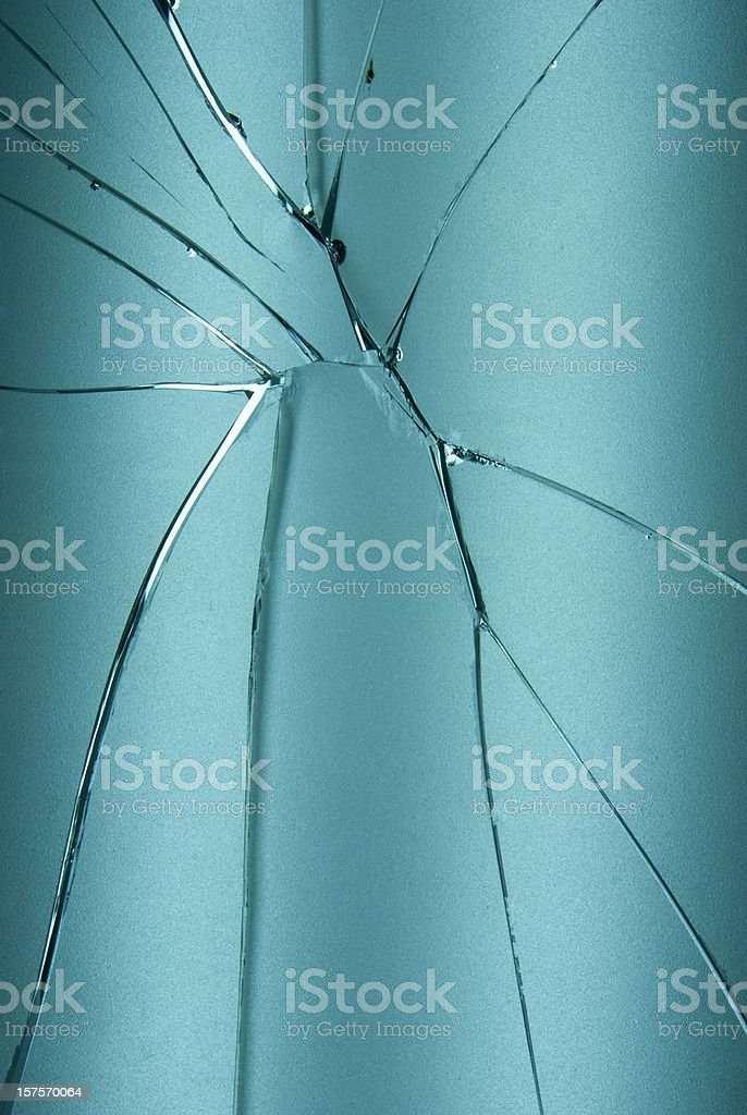 Blue shattered and broken glass background royalty-free stock photo