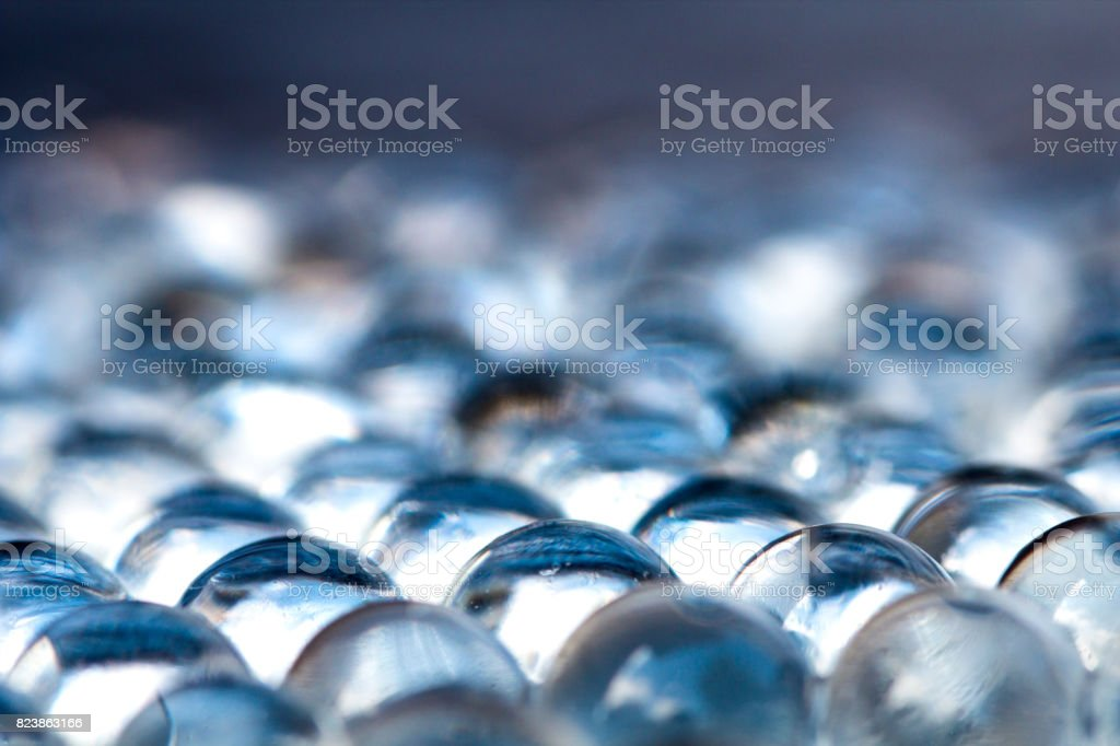 Blue shiny water gel balls. Macro photo, can be used both for advertising or cosmetics and for medicine. Abstract background. stock photo