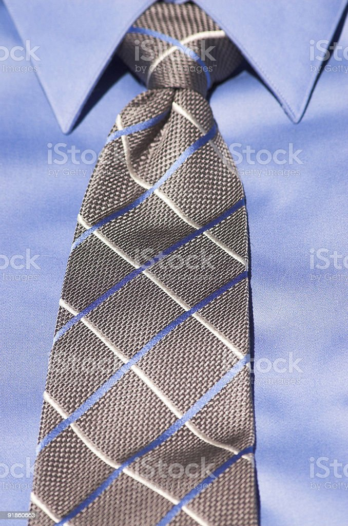 Blue shirt with striped tie royalty-free stock photo