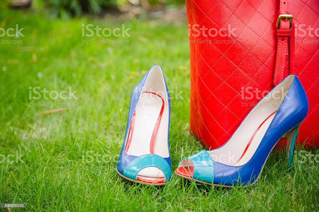 blue shoes and a red bag, leather shoes stock photo