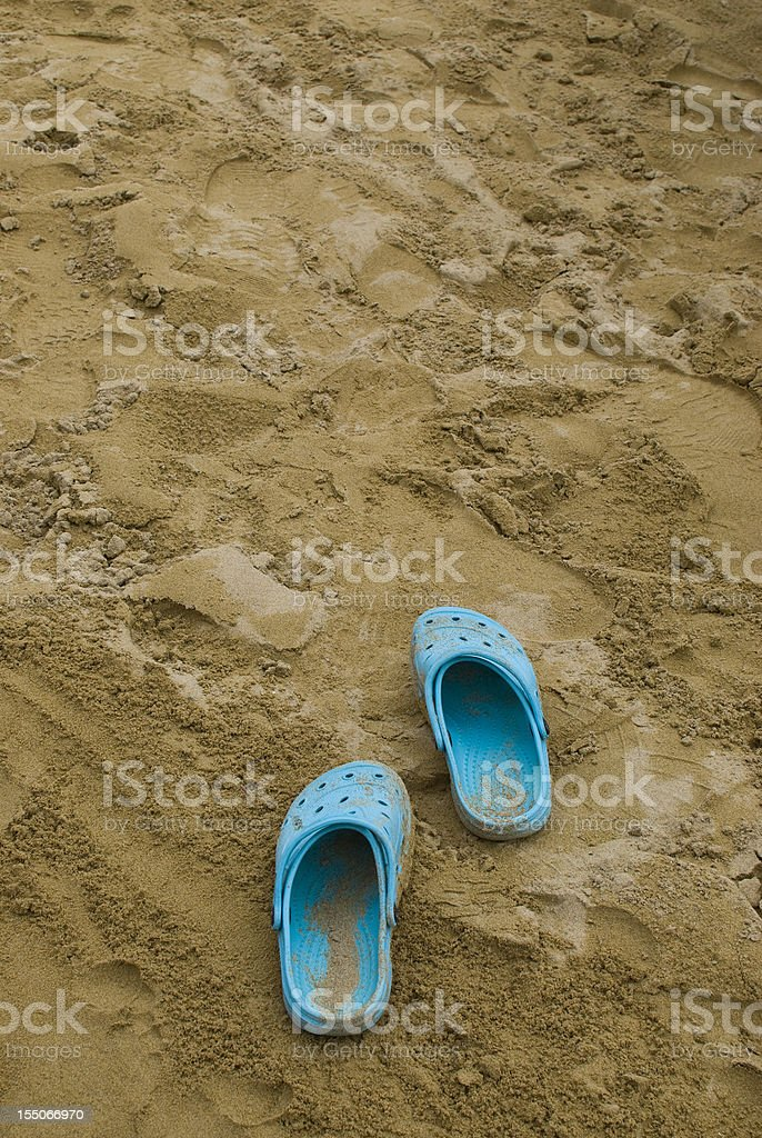 Blue shoes in the sand royalty-free stock photo