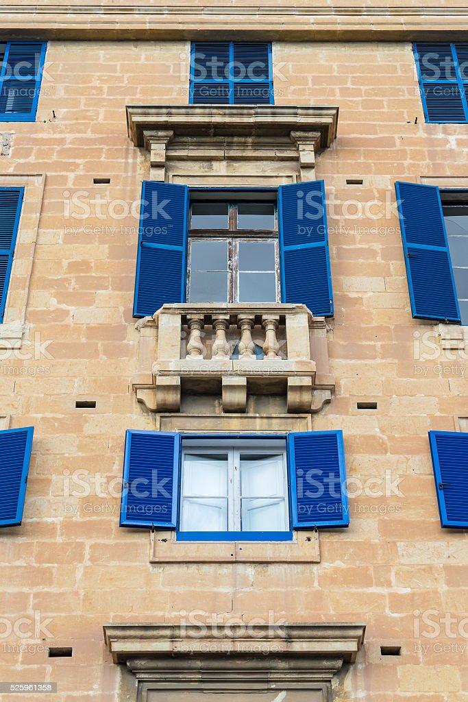 Blue shutter windows and balcony, Malta stock photo