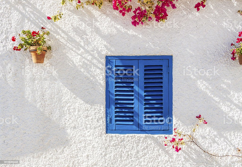 Blue Shuttered Window royalty-free stock photo