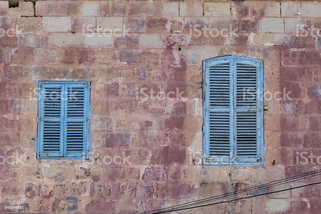 buy photo from here http://www.istockphoto.com/photo/blue-shuttered-windows-on-traditional-maltese-house-gm545348832-98232927?st=_p_malta%20shutter