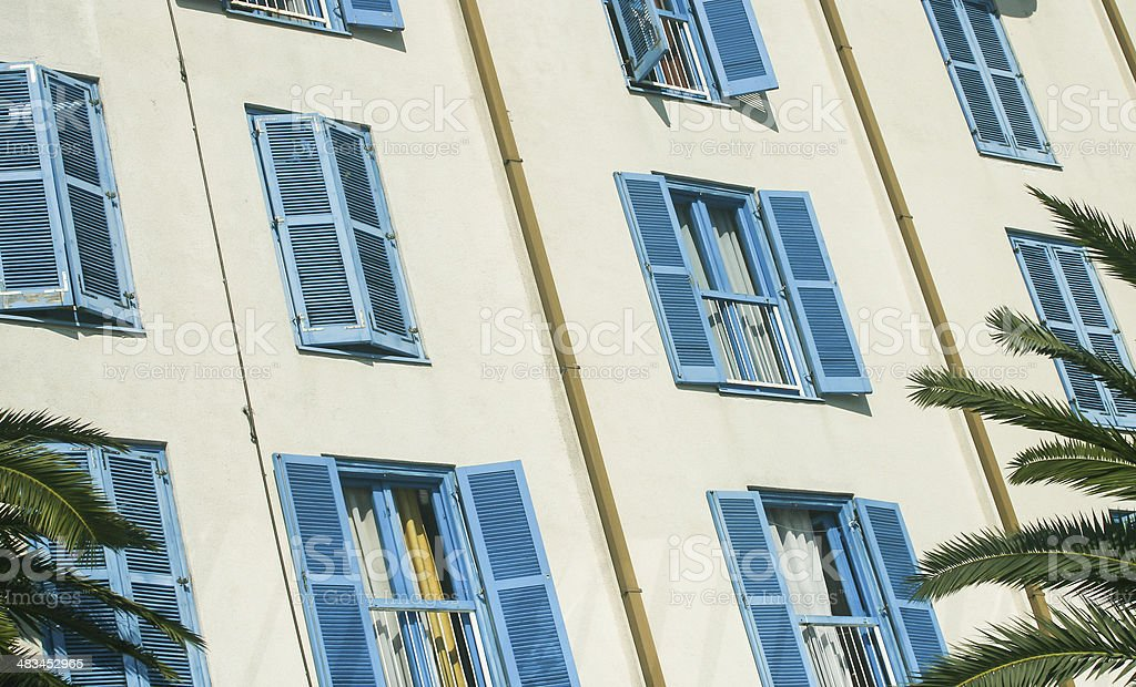 Blue shutters on a building at town Tivat - Montenegro stock photo
