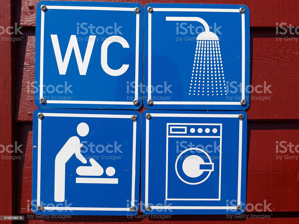 Blue sign of public toilets WC shower washing machines baby stock photo