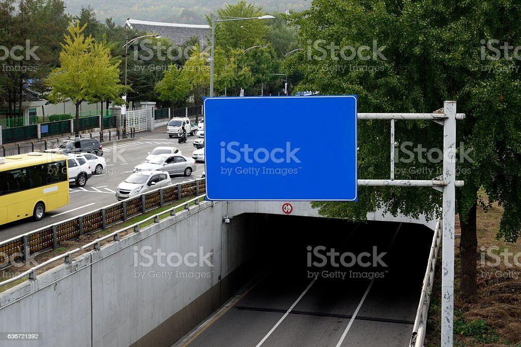 blue Signs above the road stock photo