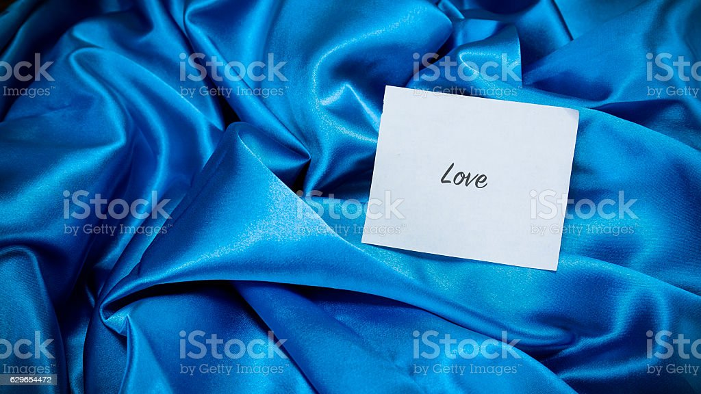 blue silk cloth, a note on the paper stock photo