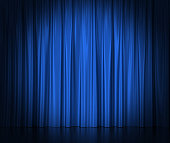Blue silk curtains for theater and cinema spotlit light in