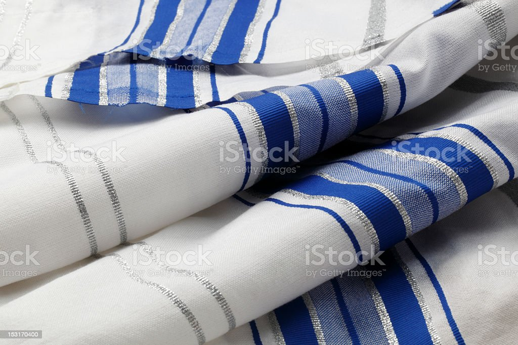 Blue, silver and white striped Tallit folded in rolls royalty-free stock photo
