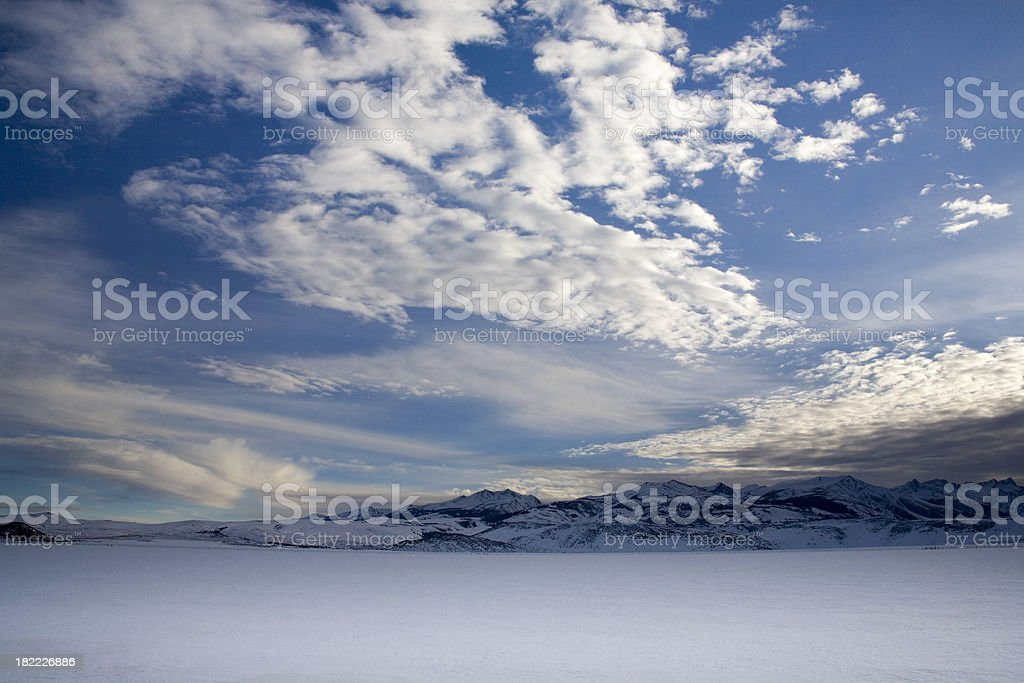 Blue skies and a snow covered field royalty-free stock photo