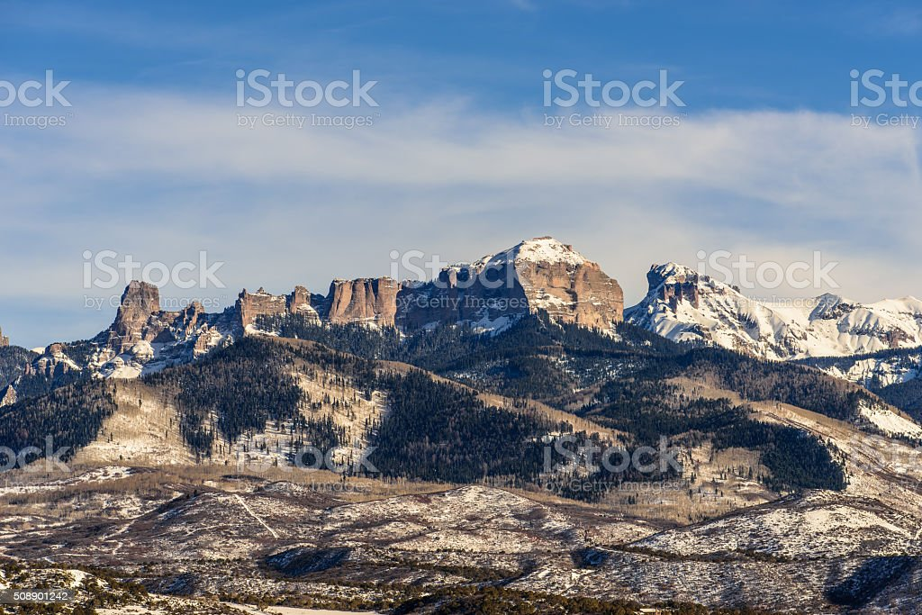 Blue skies and snow covered peaks in Colorado. stock photo