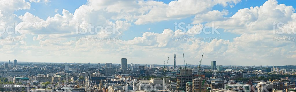 Blue skies, white clouds cityscape stock photo