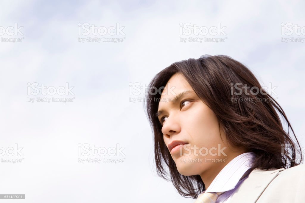 Blue sky and businessman stock photo
