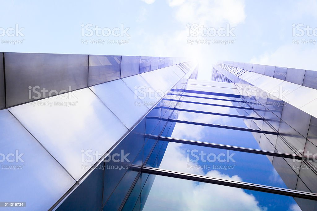 Blue sky and clouds reflected in a modern glass facade stock photo