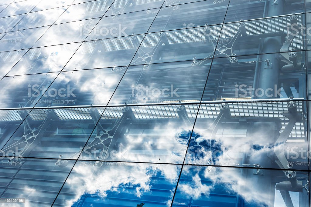 Blue Sky and Clouds Reflected in Office Block Glass Windows stock photo
