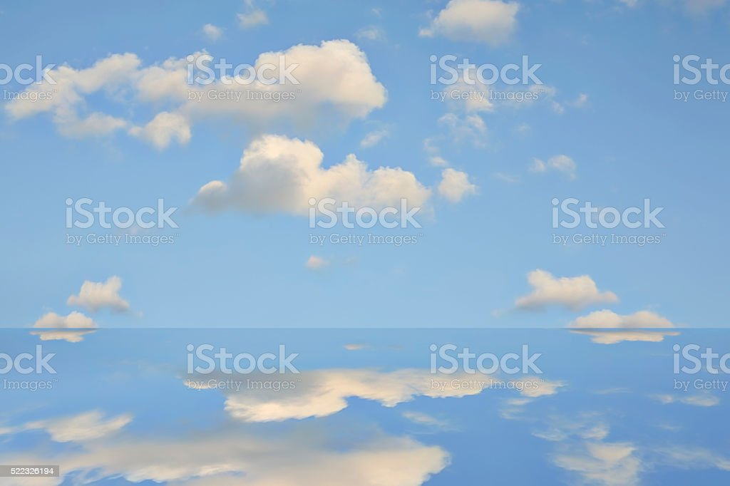 Blue Sky and clouds with mirrored reflection in water stock photo