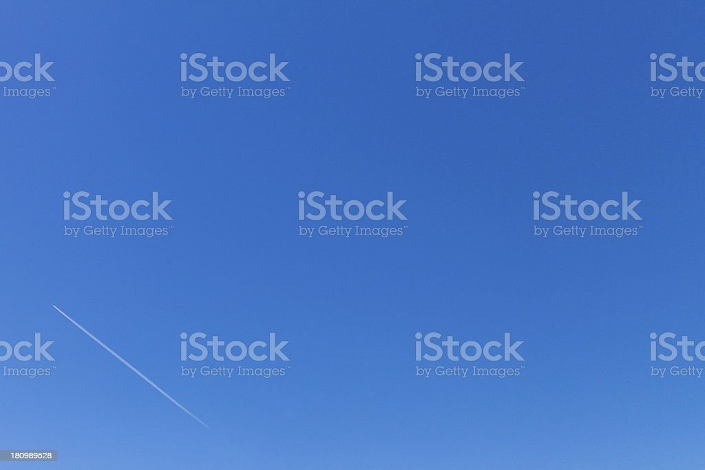 Blue sky and contrail royalty-free stock photo