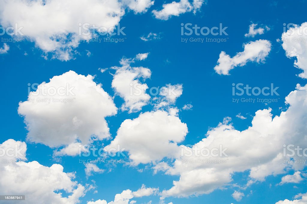 blue sky and cumulus clouds stock photo