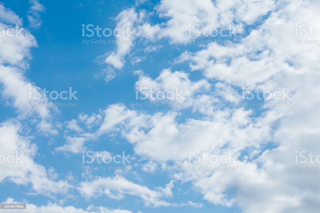 Blue sky and dramatic clouds stock photo
