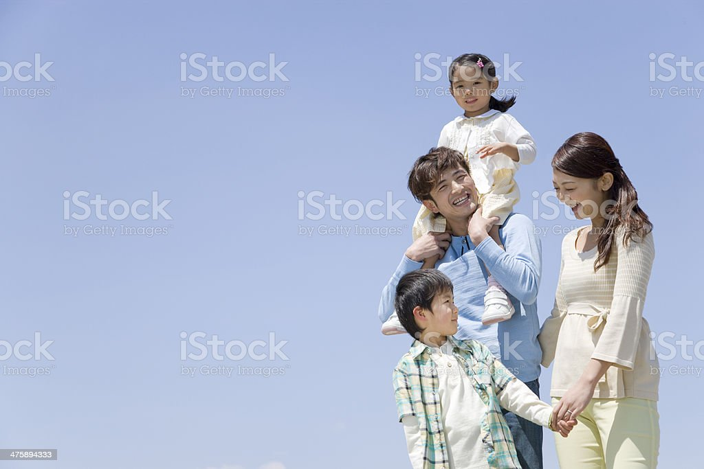 Blue sky and family stock photo
