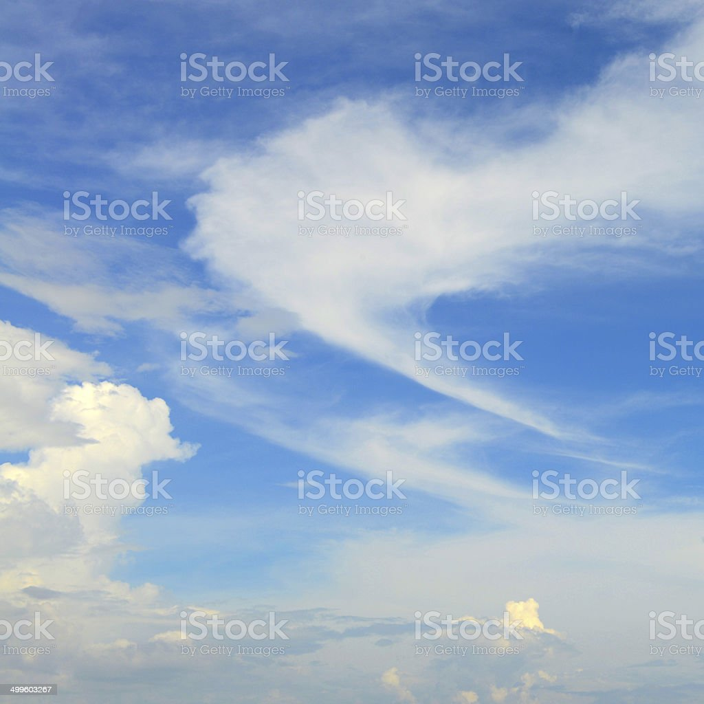 blue sky and fluffy clouds stock photo