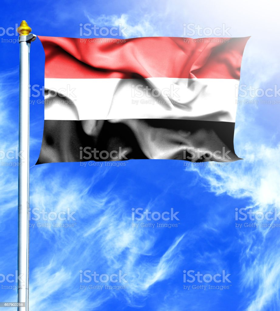 Blue sky and mast with hanged waving flag of Yemen stock photo