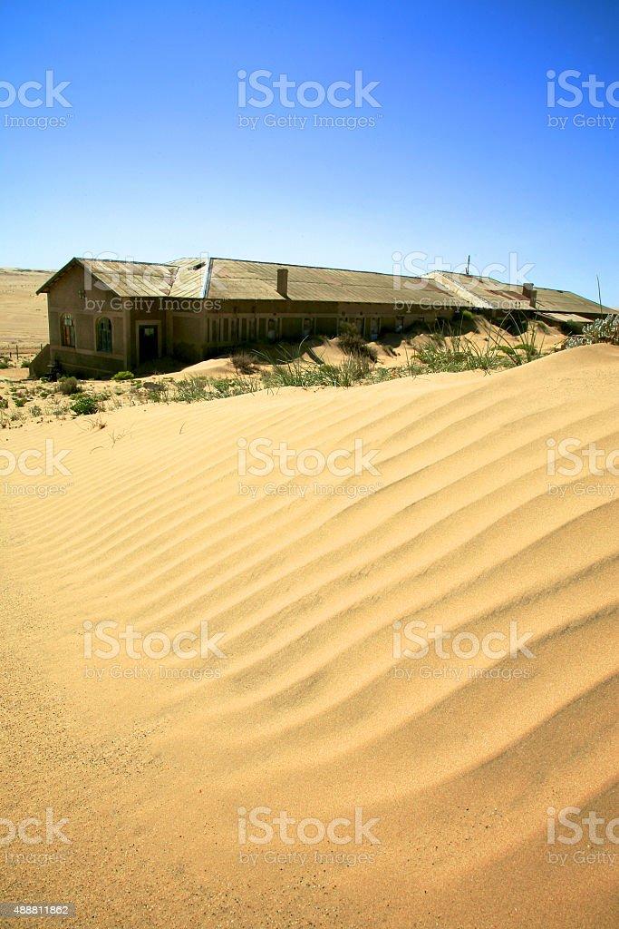 Blue sky and sand dune in Kolmanskop, Namibia stock photo