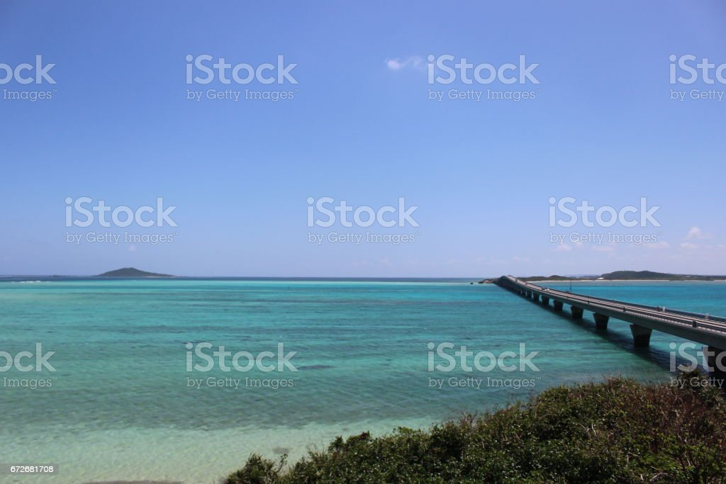 Blue sky and sea, The beach beside the ocean, there is a bridge that connects the island across the ocean in Miyako island, Okinawa, Japan stock photo