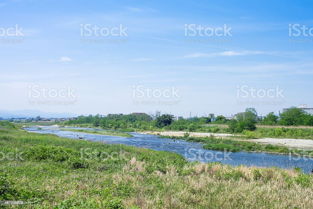 Blue sky and Tama River riverbed stock photo