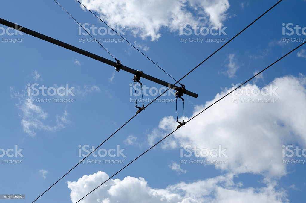 Blue sky and trolley bus wires stock photo