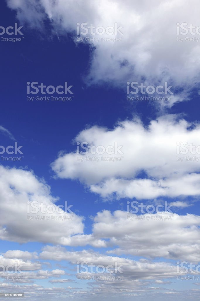 blue sky and white clouds vertical royalty-free stock photo