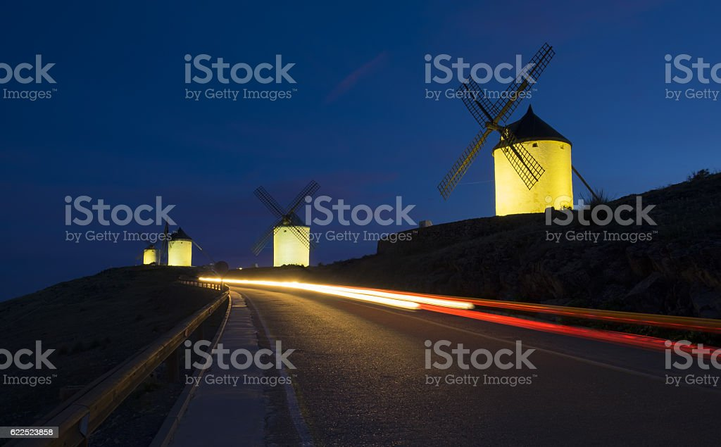 Blue sky and windmills at night stock photo