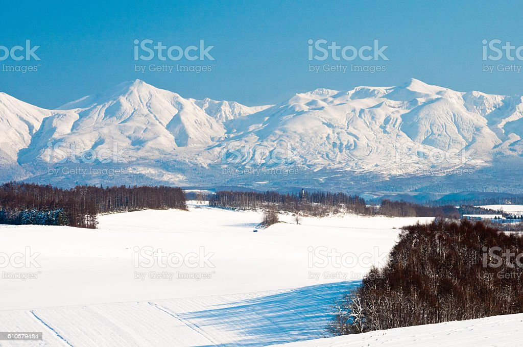 Blue sky and winter mountain stock photo