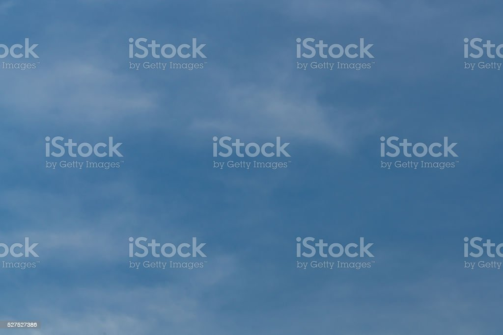 Blue Sky and Wispy White Cloud Background royalty-free stock photo