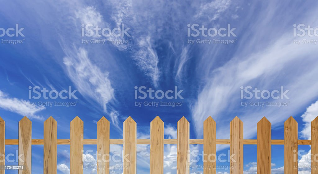 blue sky and  wood fence royalty-free stock photo