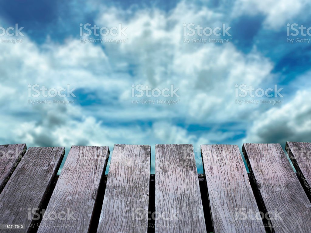 Blue sky blurred background and old brown wooden floor. royalty-free stock photo