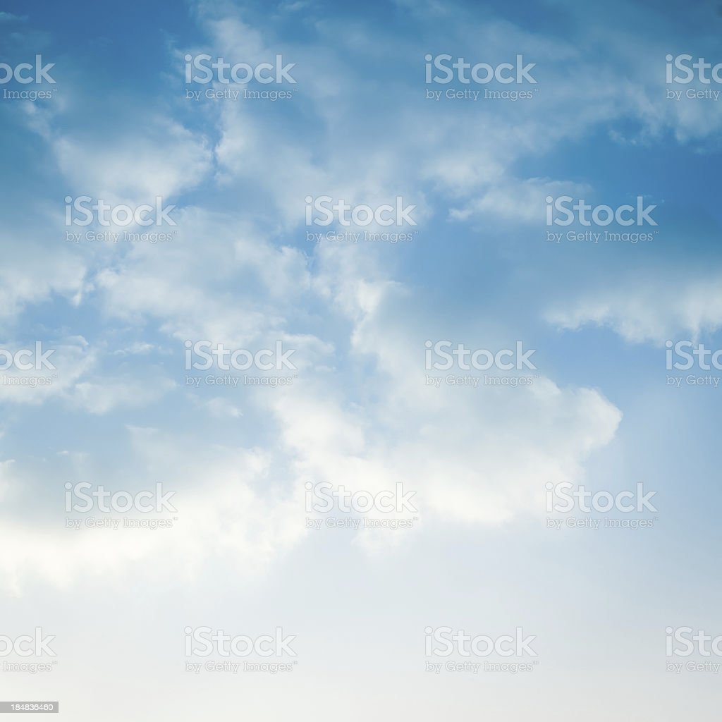 Blue sky filled with fluffy white clouds stock photo