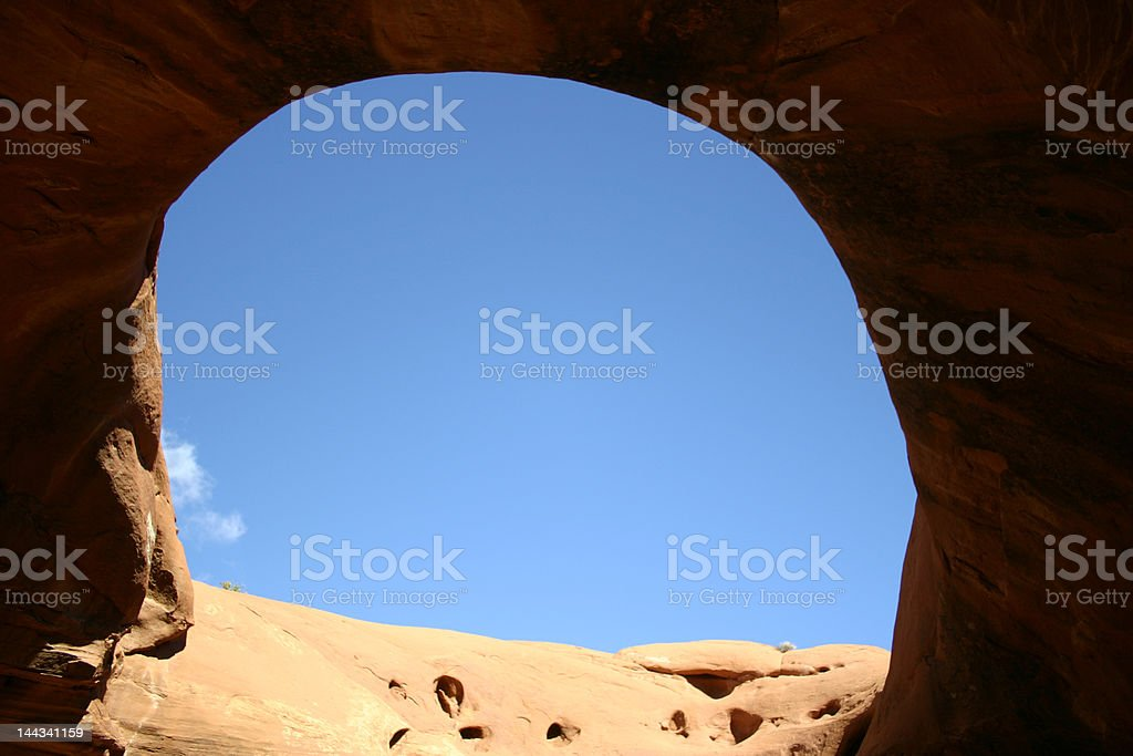 Blue sky from a big hole stock photo