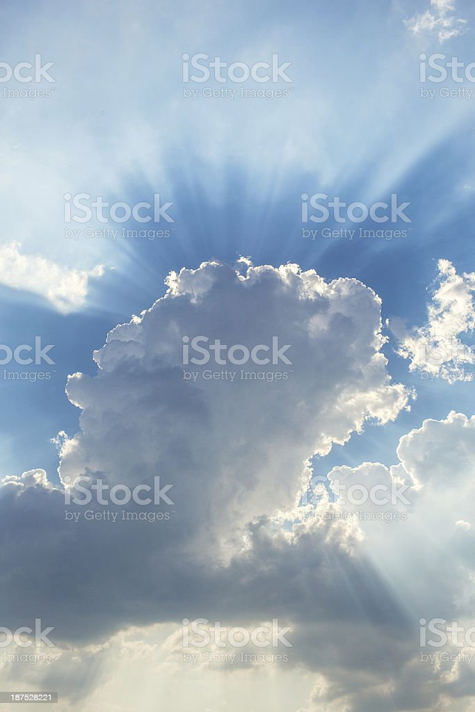 Blue Sky Full of Clouds and Sunbeams stock photo