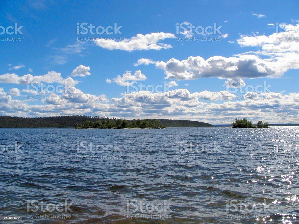 Blue sky, lake, horizontal orientation royalty-free stock photo